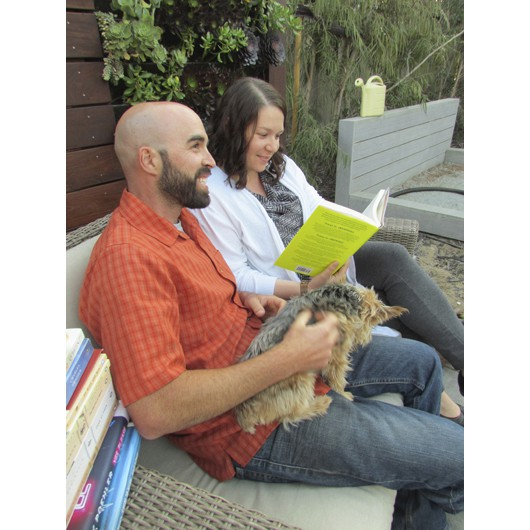 Joey and Danielle take a breather with one of the pooches